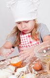 Girl in chef's hat Stock Image