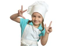 Girl in chef uniform showing fingers Royalty Free Stock Images