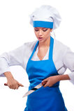Girl in chef uniforms Royalty Free Stock Photos