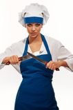 Girl in chef uniforms Stock Image