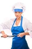 Girl in chef uniforms Stock Photos