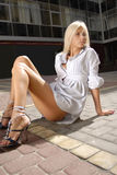 Girl in chemise. Beautiful blonde girl in chemise on floor of shopping mall Stock Photo