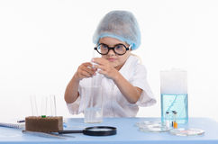 Girl chemist gets a new formula of chemical compound Royalty Free Stock Photo