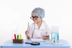 Girl chemist holding tweezers Royalty Free Stock Photo