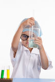 Girl chemist mixes the contents of flask Stock Images