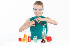 Girl in chemistry class, chemistry lesson Royalty Free Stock Photos