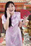 Girl in cheongsam dress screaming in the temple Royalty Free Stock Photography