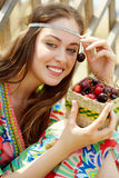 Girl with cherries Stock Images