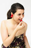 Girl with cherries. A preety girl tasting some cherries Stock Photography