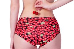 Girl with cherries. Girl holding a cherry berries Royalty Free Stock Image