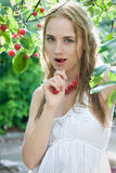 Girl with cherry Stock Images
