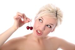 Girl with cherry Stock Photography
