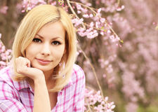 Girl with Cherry Blossom. Beautiful Blonde Young Woman Royalty Free Stock Photography