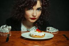 Girl with cherry fancy cake Royalty Free Stock Photo