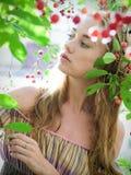 Girl in cherry garden Stock Photos