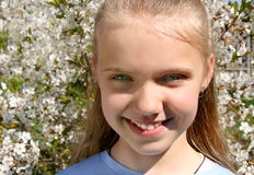 Girl in cherry garden Royalty Free Stock Photography