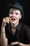 Girl with cherry in mouth Royalty Free Stock Photography