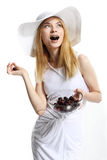Girl with cherry in mouth Stock Photography