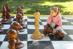 The girl and chess Royalty Free Stock Photos