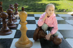 The girl and chess Royalty Free Stock Images