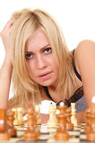 girl and chess Stock Images