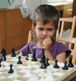 Girl with chess Royalty Free Stock Images