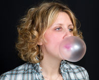 Girl with chewing gum Royalty Free Stock Images
