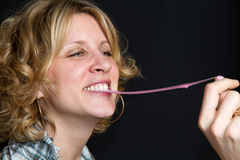 Girl with chewing gum Stock Image
