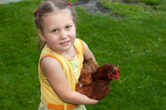 Girl with chicken Stock Image