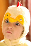 Girl in chicken clothes Royalty Free Stock Photography