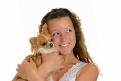 Girl and chihuahua. Woman and  her chihuahua in front of white background Stock Photos