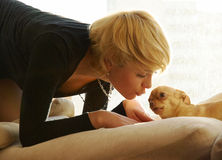 Girl and chihuahua in sun light Stock Image
