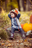Girl child in autumn forest. Stock Photo