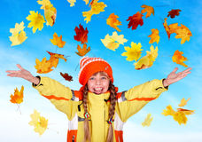 Girl child in autumn orange hat with outstretched Stock Images