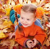 Girl child in autumn orange leaves. Stock Photography