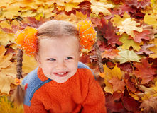 Girl child in autumn orange leaves. Royalty Free Stock Photos