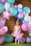 Girl child with balloons. In the studio stock images