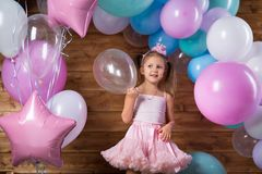 Girl child with balloons. In the studio royalty free stock photography