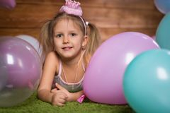 Girl child with balloons. In the studio stock image