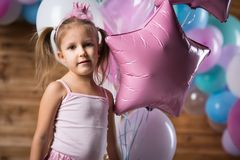Girl child with balloons. In the studio stock photo