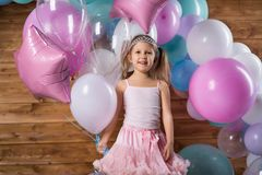 Girl child with balloons. In the studio royalty free stock images