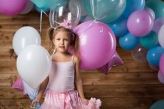 Girl child with balloons. In the studio royalty free stock photo