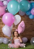 Girl child with balloons. In the studio royalty free stock image