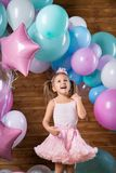 Girl child with balloons. In the studio stock photos