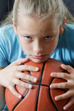 Girl child with basketball, portrait. Royalty Free Stock Image
