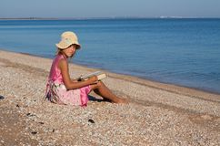 Girl child at the beach Royalty Free Stock Image