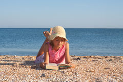 Girl child at the beach Stock Images