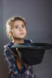 Girl child beggar just money for food keeps his Royalty Free Stock Photo