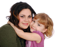 Girl and child big hug. Studio shot Royalty Free Stock Photos