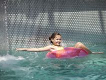 Girl child in blue water of the swimming pool Royalty Free Stock Photography